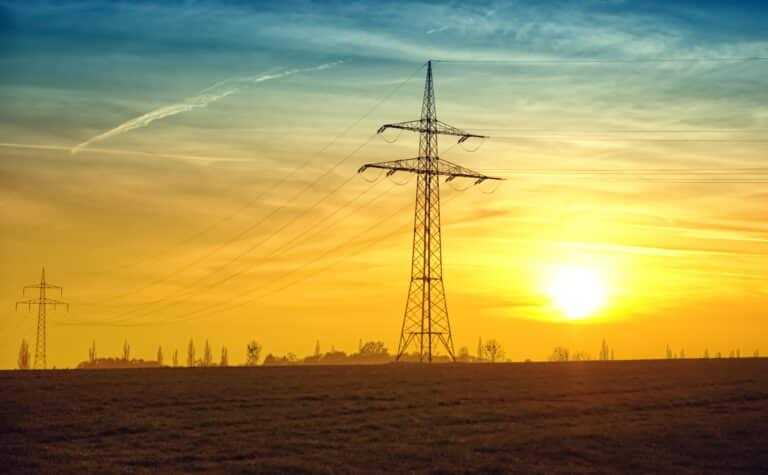 Electric pilone on a sunny landscape, stands for energy, sun and nature